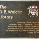 Dedication wall plaque by the library's main entrance.